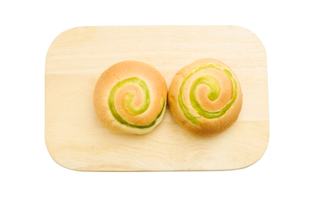 top view of isolated bread filled with green custard