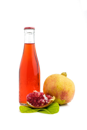bottle of juice and pomegranate on white with clipping path Stock Photo
