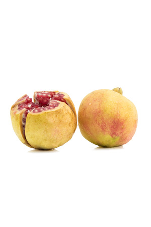 cut pomegranate fruit on white with clipping path, fresh fruit for health Stock Photo