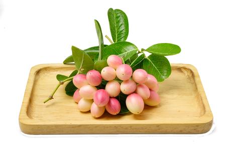 isolated carandas fruit on wood tray Stock Photo