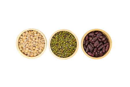 Top view of kind of beans including soybean, red beans, mung beans in wood cup align on white background