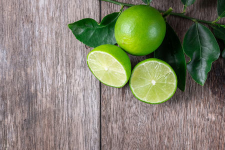 top view of sliced lime on wood, rich source of Vitamin C, often used to accent of food and beverages Stock Photo