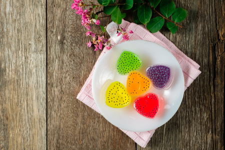 Thai traditional recipe made from coconut milk and agar agar powder blending with water. its color flavor from nutural raw such as green color is made from pandan leaf, purple made from butterfly pea