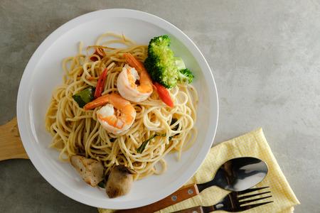 spaghetti spicy stir fried with prawn, mushroom and broccoli, healthy food with copy space Stock Photo
