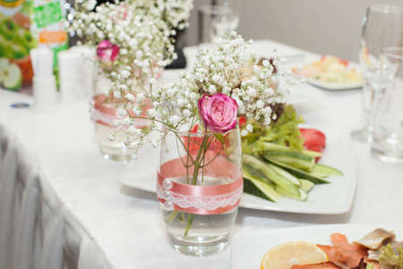 baby's: Jar with rose and babys breath. Wedding decorations. Close-up