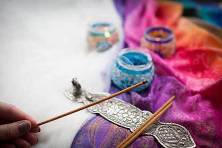 hand holding incense on white background Stock Photo