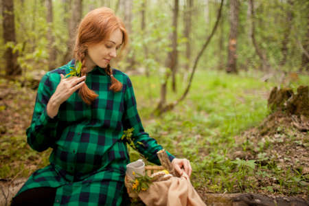 pregnant girl in the woods on a picnic Stock Photo