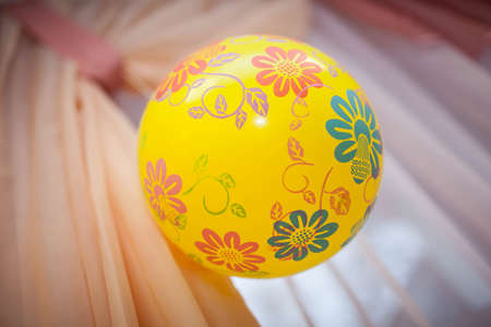 yellow ball with patterns weighs Stock Photo
