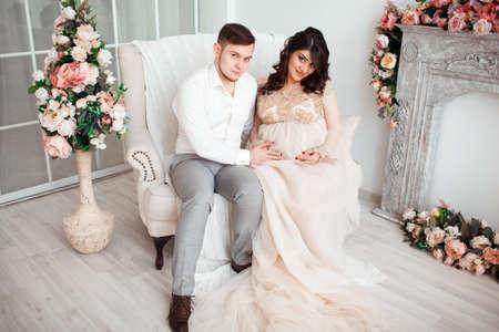 fondling: beautiful cute pregnant woman