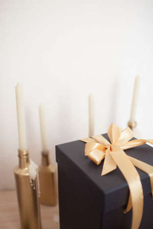 Beautiful black gift box with gold bow. Stock Photo