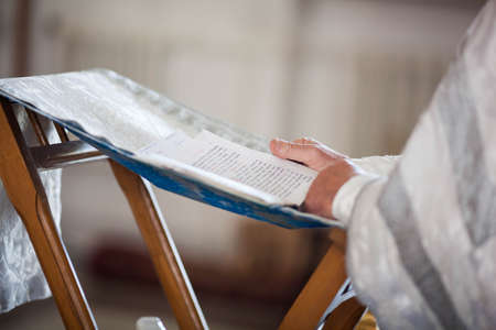 Orthodox priest reads a prayer
