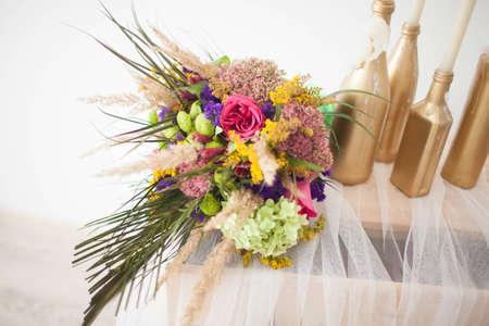 wedding bouquet on his dresser