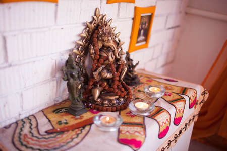 The altar of Ganesha with candles
