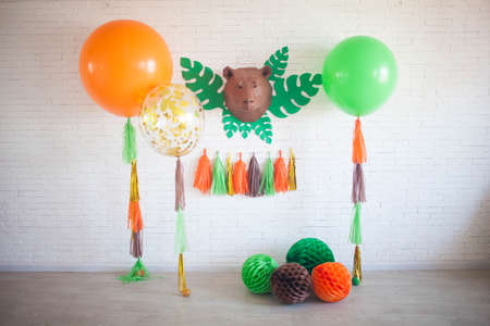 Table beautifully decorated for a colorful birthday party. Colorful balloons