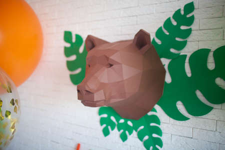 polygonal head of a bear hanging on the wall