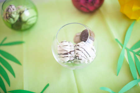 Chocolate marshmallow on the table. Beautiful table for a children's party. Stock Photo