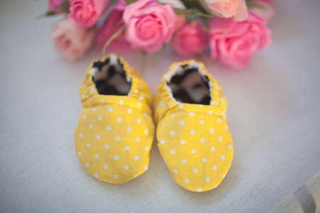 yellow fabric newborn baby shoes. Close up Stockfoto