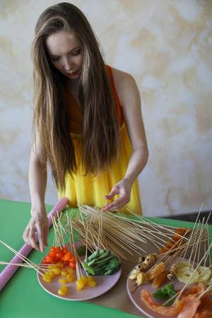 Young woman florist making fruit bouquet Stockfoto
