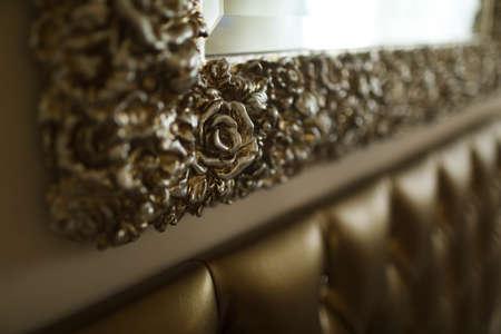 Golden mirror frame on the wall Stockfoto