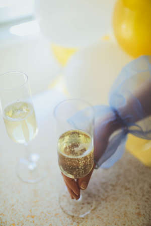 Pouring champagne in flutes standing on table