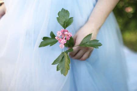 Wedding bouquet holding groom, elegant flowers