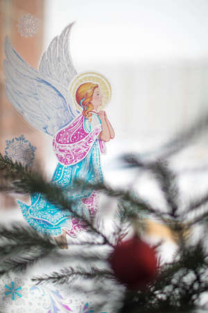 Christmas sticker on the window angel