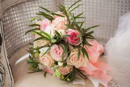 Delicate wedding bouquet of white and pink roses.Delicate wedding bouquet of white and pink roses. Close up