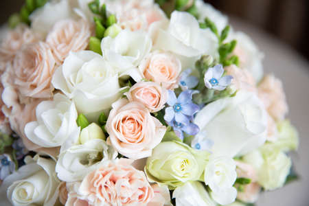 Delicate wedding bouquet of white and pink roses.Delicate wedding bouquet of white and pink roses