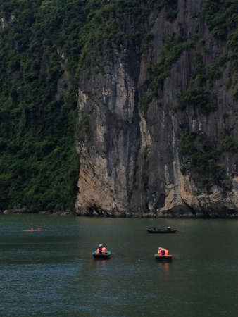 limestone caves: Kayaking at Ha Long Bay Vietnam which is surrounded by limestone caves