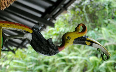 The bird wooden craft named enggang is a famous bird species in borneo island. Stock Photo