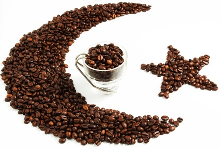 Cup of coffee with composition of coffeee beans on the white background Stock Photo