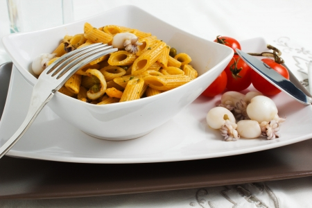 Pasta with cuttlefih with tomatoes