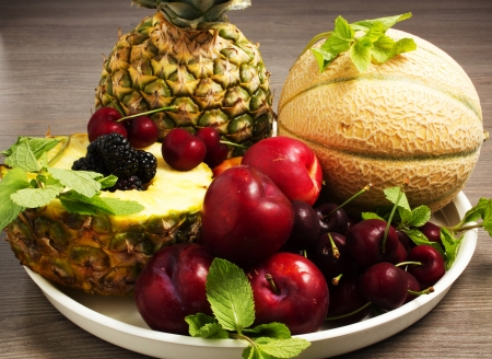 Composition of fresh fruit on the table photo