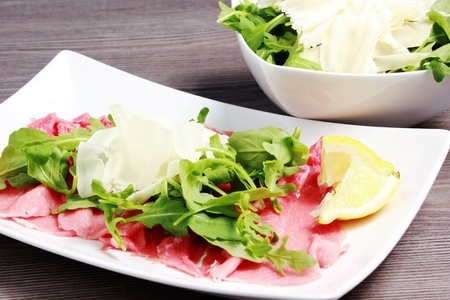 aliments: Meat carpaccio on the table