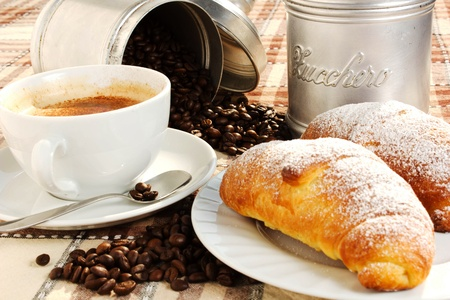 brioches with cup of coffee and sugar photo