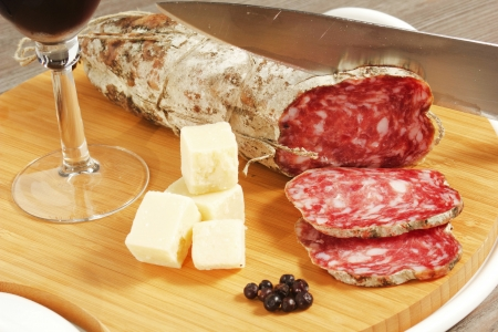 salami and cheese on a wood table Stock Photo