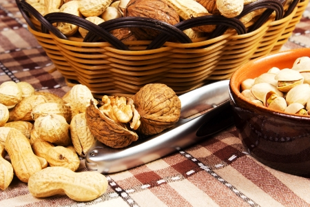 variety of nut on the table with nutcracker photo