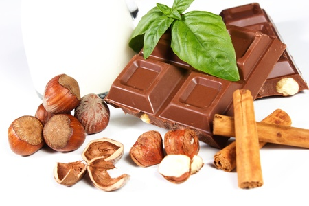 chocolate ith hezelnuts and cinnamon on a white background Stock Photo - 15198459
