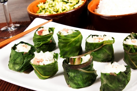sushi meat on the table with zucchini and rice