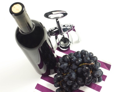 bottle of wine red with corkscrew on a white background photo