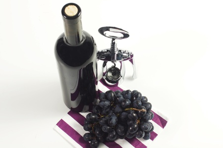 bottle of wine red with corkscrew on a white background