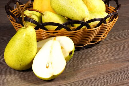 bowl with fresh pears isolated on the table Stock Photo - 15014201