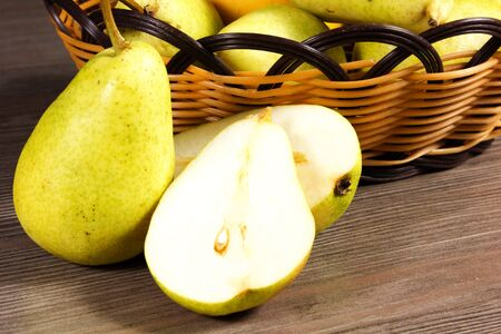 bowl with fresh pears isolated on the table Stock Photo - 15014198
