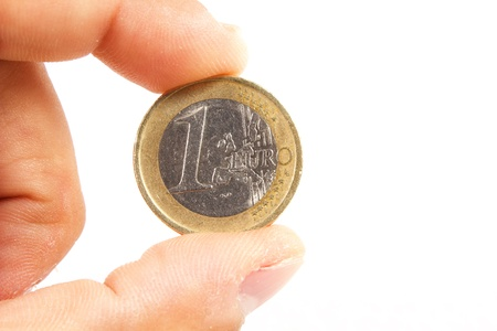 One euro coin on white with hand photo