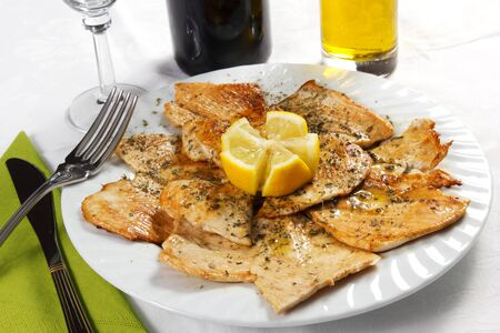Grilled lemon chicken with garlic bread,Closeup
