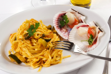 pasta with scallops and zucchini on the table