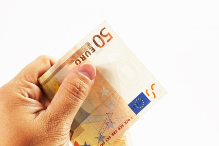 euro money on a white background with hand Stock Photo - 15456773