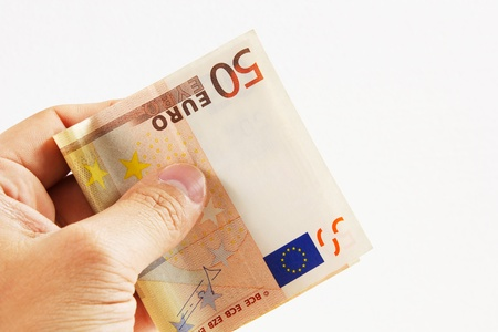 euro money on a white background with hand Stock Photo - 15456765