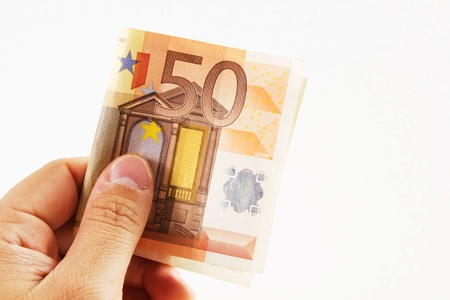 euro money on a white background with hand