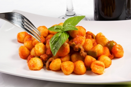 homemade gnocchi with tomato sauce, selective focus
